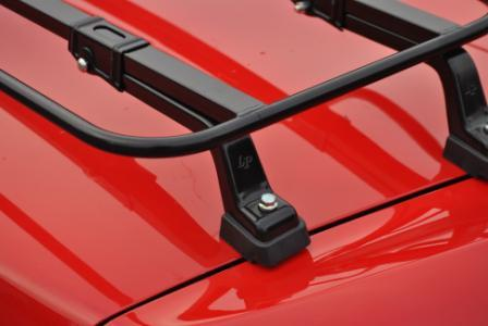 close up of luggage rack feet on porsche boxster